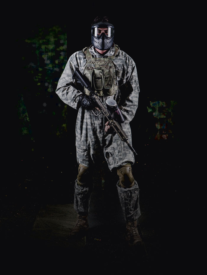 male paintball player in full flight suit and gear