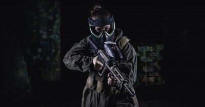 women in paintball getup